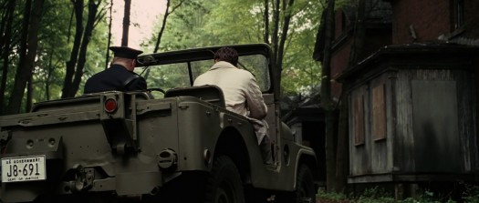 A military jeep with government plates on Shutter Island